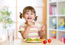 toddler enjoying a healthy meal