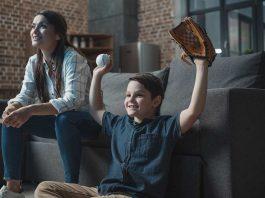 kid watching baseball movie with mom
