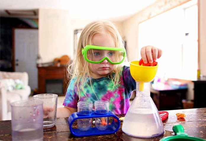 toddler carrying out a science experiment