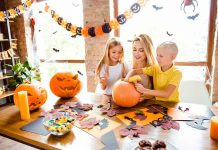 children making pumpkin craft with mother