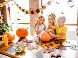 children making pumpkin craft with mother