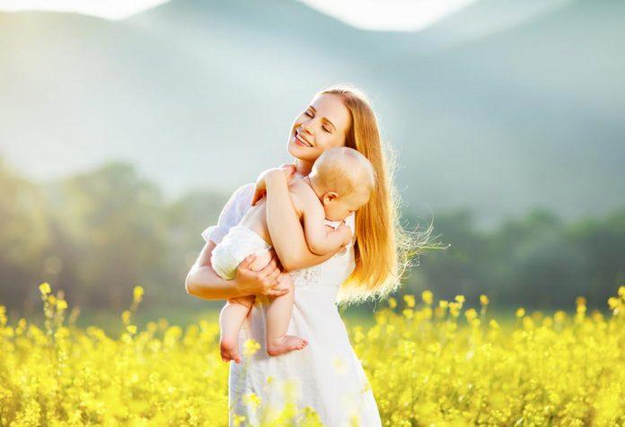 mother holding her toddler lovingly