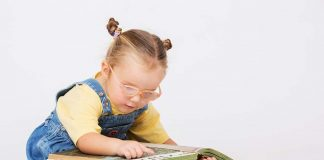 toddler reading a picture book