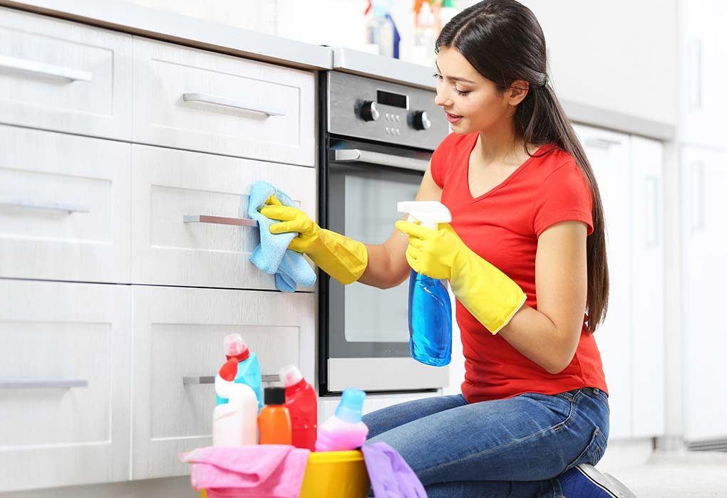 cleaning the house with gloves