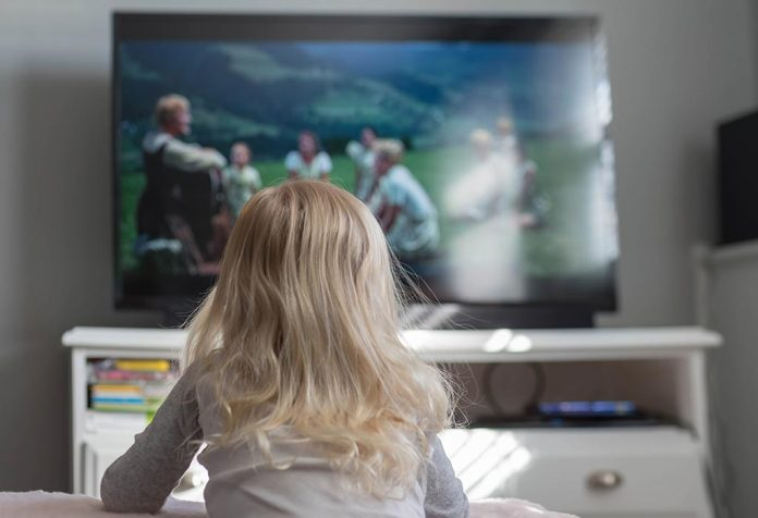 kid watching the sound of music on TV
