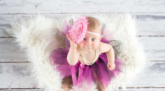 baby wearing a large headband