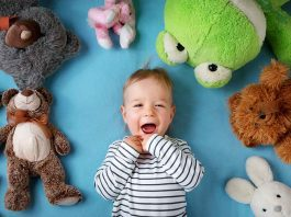 16-month-old toddler with his stuffed toys