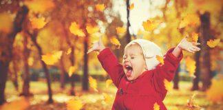toddler enjoying autumn