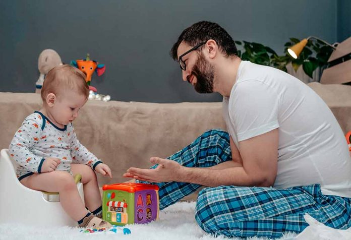 father potty training baby