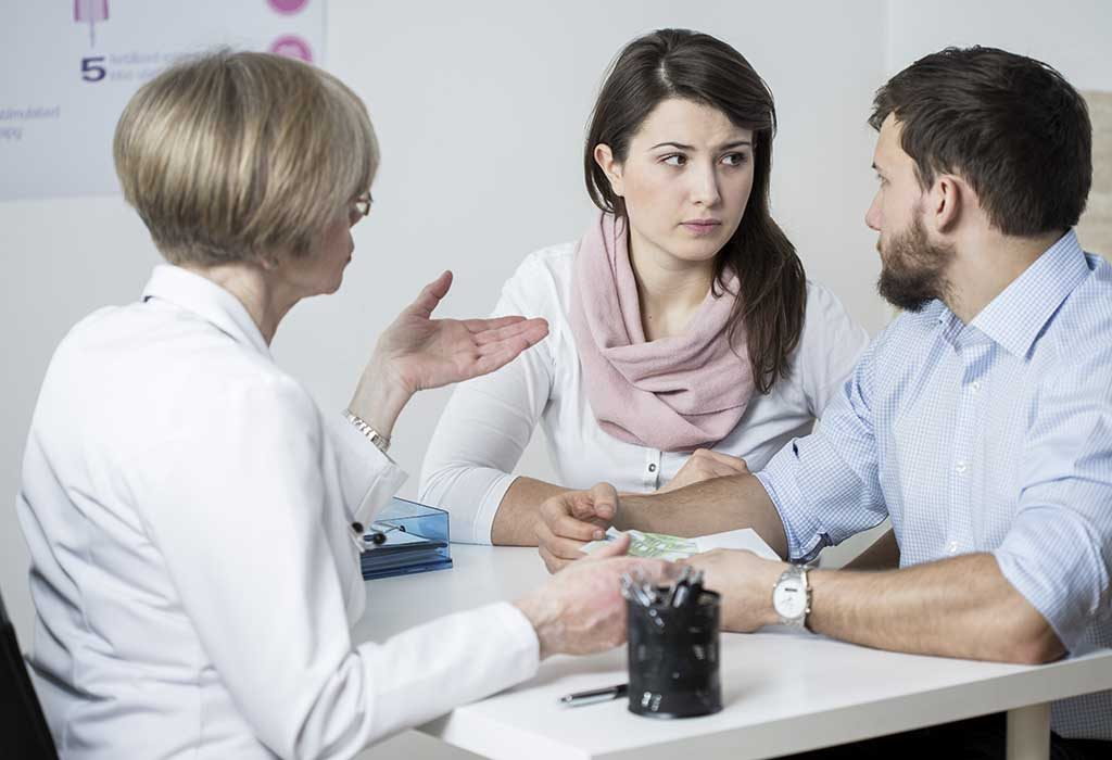 A married couple discussing IVF treatment cost