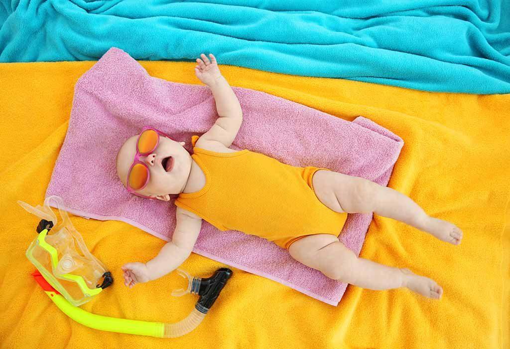 baby sleeping in beach/scuba props