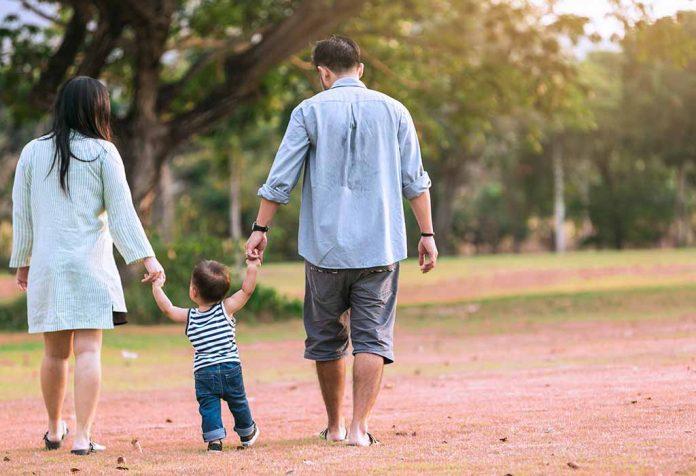 parents walking their child