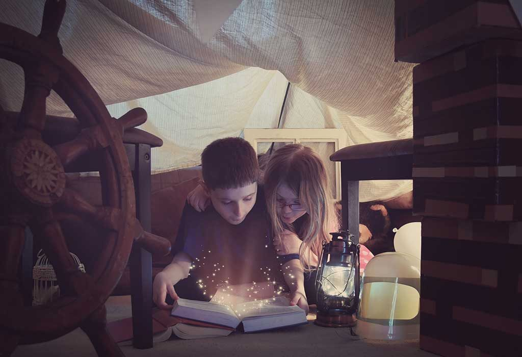 2 kids reading a fantasy book together