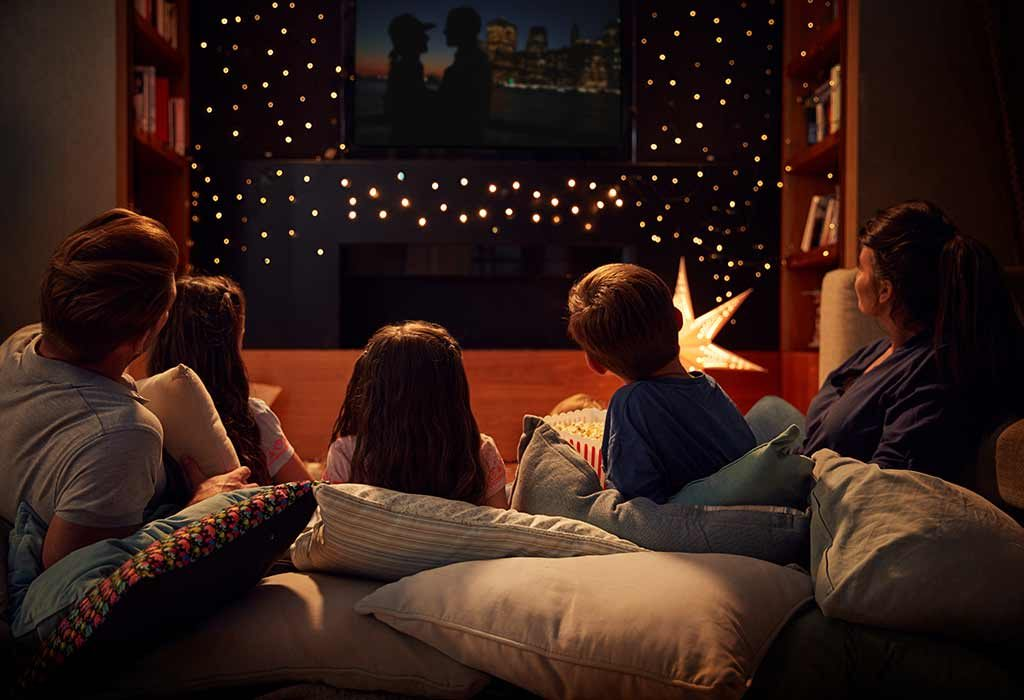 Family watching a movie at home