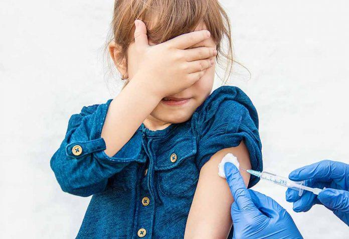 child getting an immunization vaccination