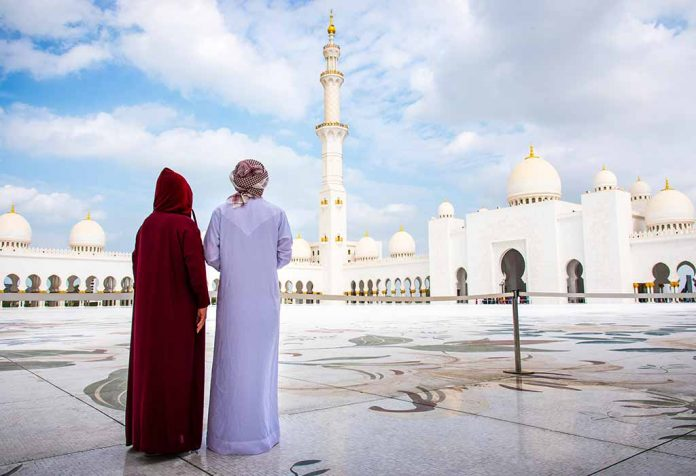 Arab couple visiting a mosque