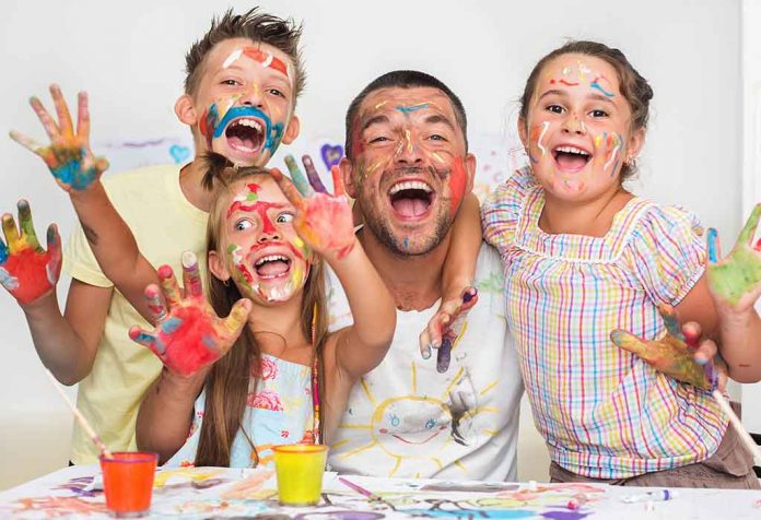 colour-stained family enjoying tie-dye activity