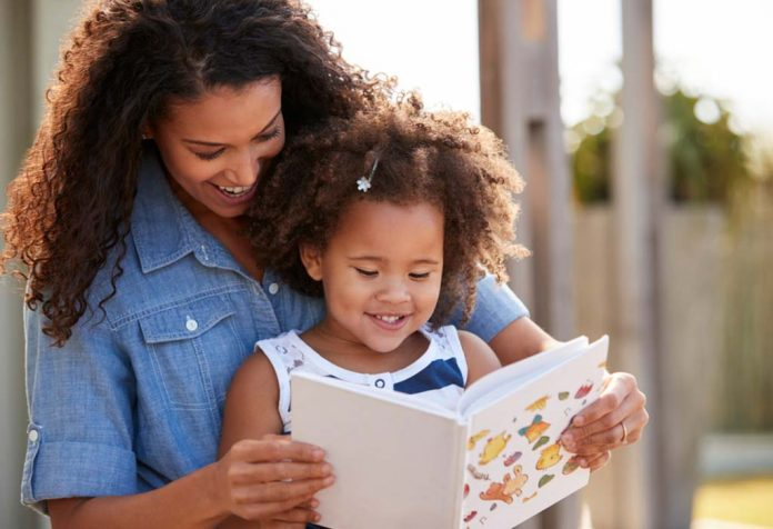 mom reading a book for toddler