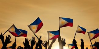 people waving the National flag of Philippines
