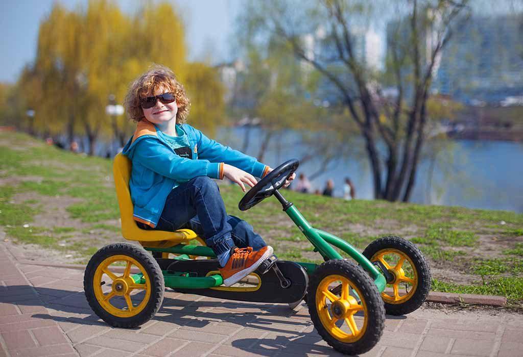 kid riding a quad bike