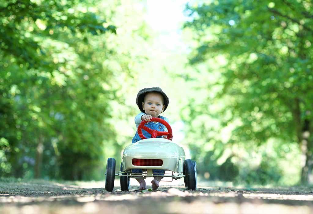 Baby riding a pedal car