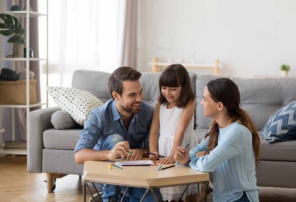 girl learning at home with family