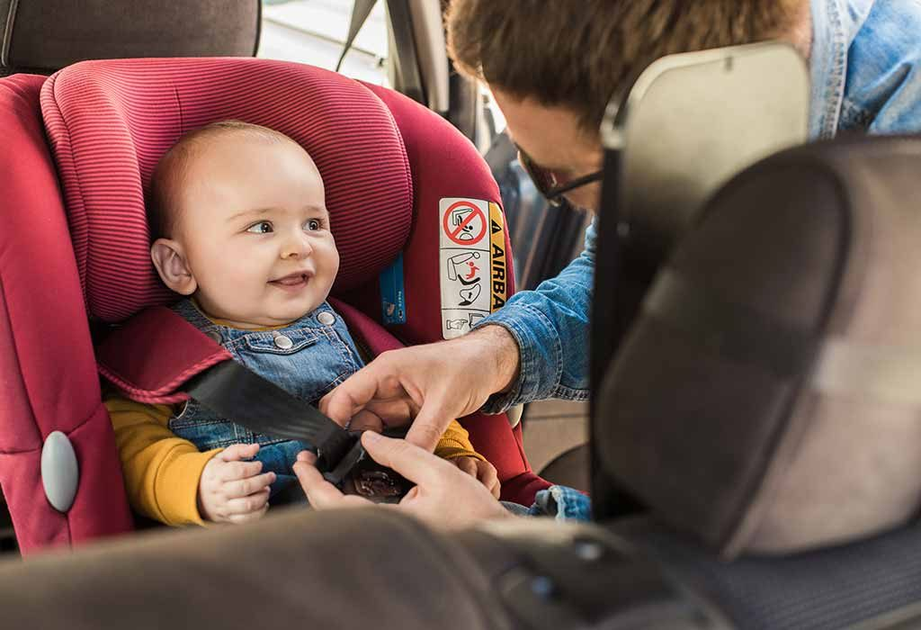 A parent checking the safety harness in a car