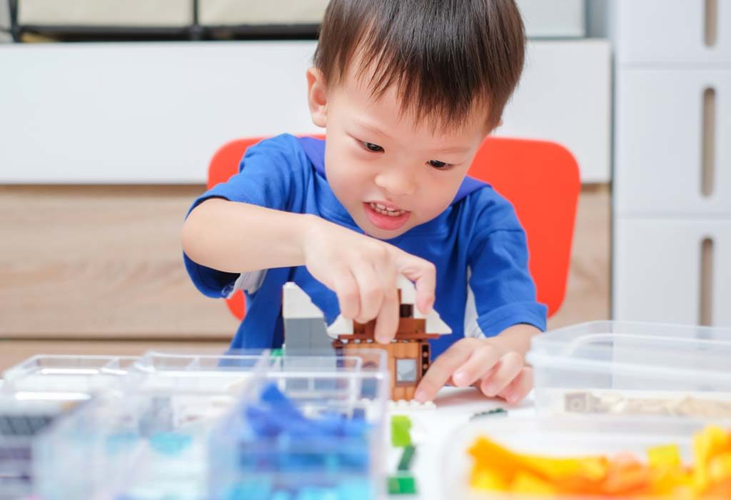 toddler playing with STEM toy