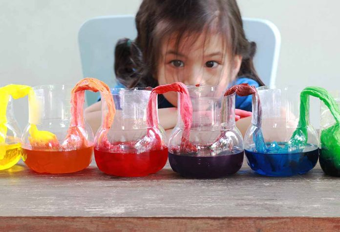 kid doing the water rainbow experiment