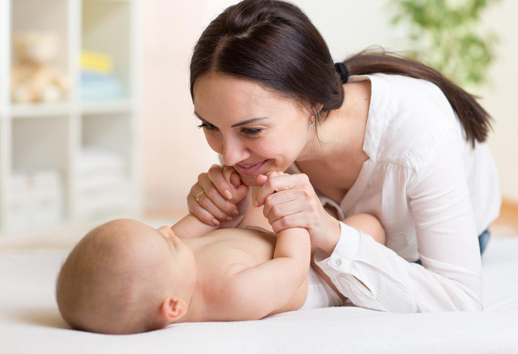 mother massaging baby