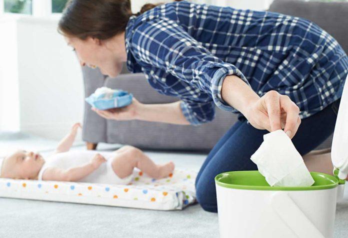 mom disposing of a used Babuhug baby wipe