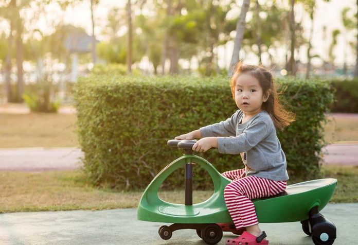 child riding a swing car