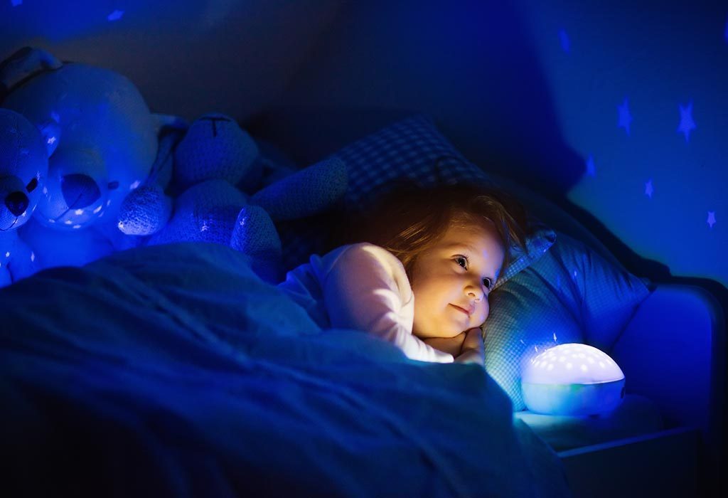 kid sleeping with a night light on
