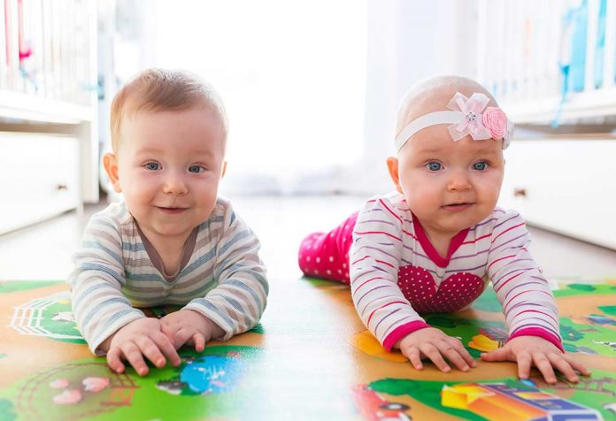 babies playing on a playmat