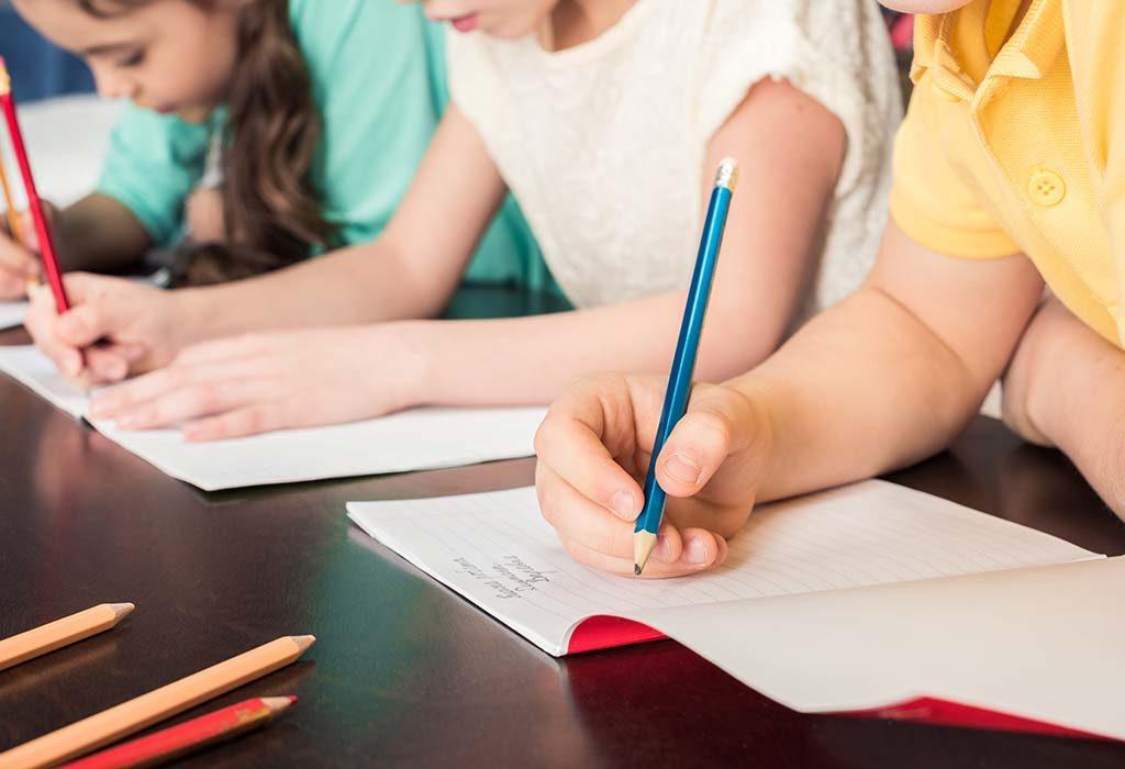 kids taking an exam in school