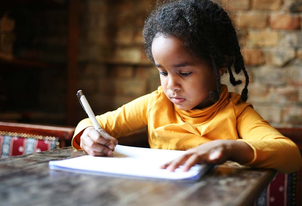 child writing an essay at home