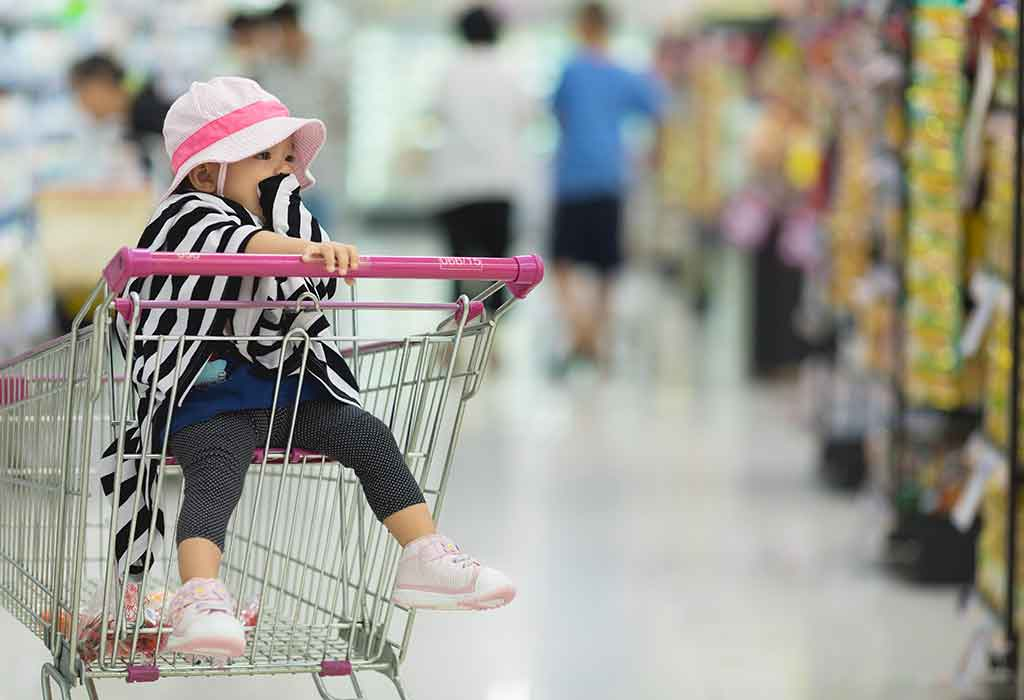 baby in shopping cart