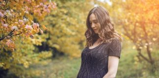 expecting mom having a silent word with her unborn baby