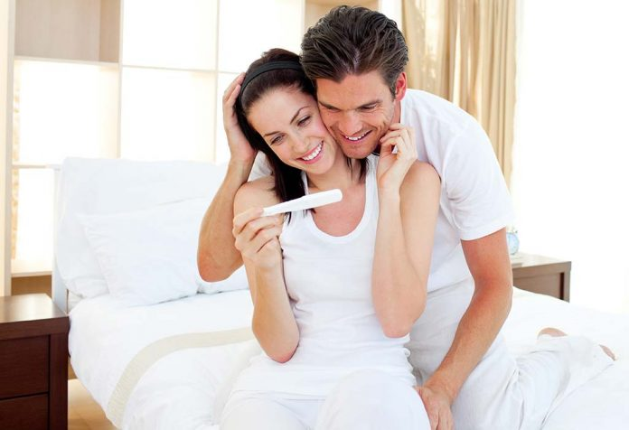couple excited about positive pregnancy