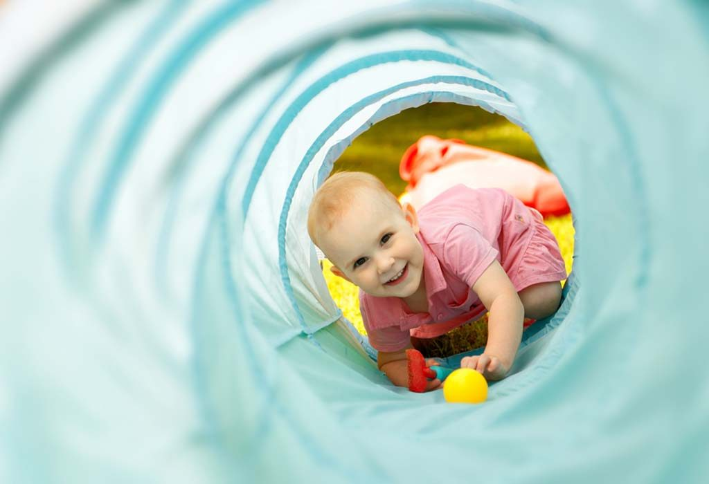 Child playing in tunnel