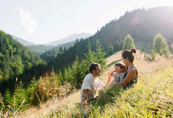 toddler with family on a hilltop