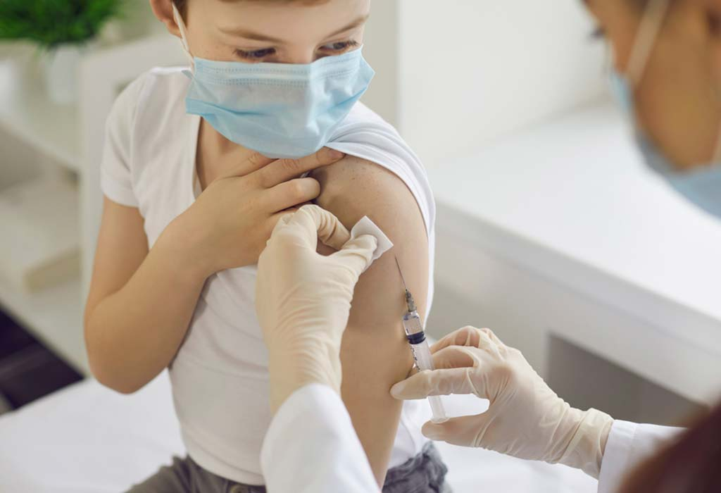 image representation of kid taking the COVID-19 vaccine